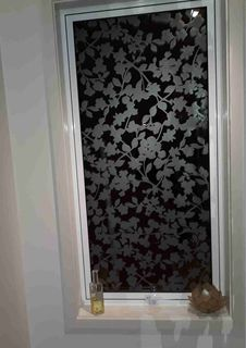 Etched floral window design