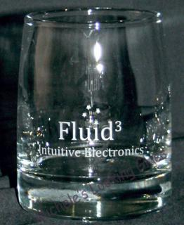 Logo etched onto whiskey glass