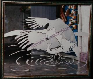 Eagle etched onto framed mirror