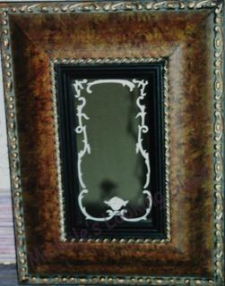 Design etched on small framed mirror