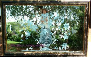 Large Sandblasted and framed mirror with floral design