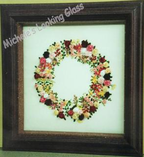 Two hand finished frames, inner one lifts glass off needlework