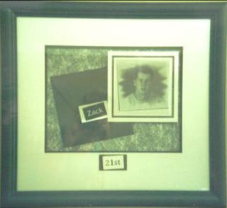 The card and photo are floated and a plaque created which is attached to the top matboard