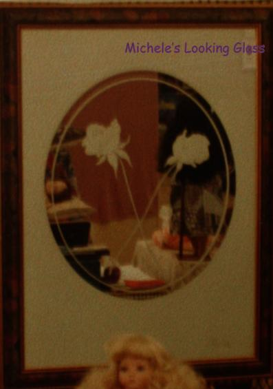 Etched and framed mirror with rose image